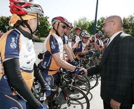 Vojmir Urlep shaking hands with the cyclists, wishing them luck before the tour.